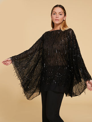 Poncho with fringe and sequins